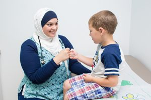 Dr. Ameera Nauman sees a pediatric patient