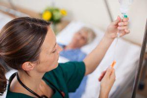 a nurse prepares an IV