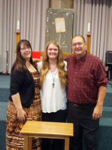 Christine Bathe with her family at church