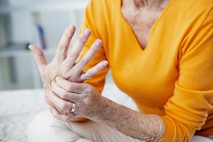 a woman with osteoarthritis in her hand