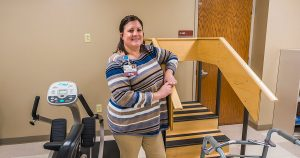 Mission Partner poses with model stairs for rehabilitation patients