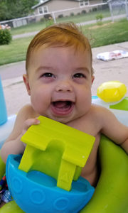 Baby smiling in a pool
