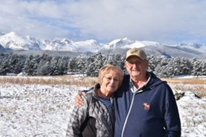 Ron and Melinda Cooling standing by mountains
