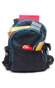 child's backpack loaded with school supplies