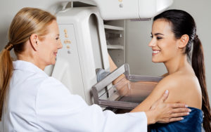 physician performing a mammogram