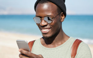 man taking a selfie on a beach