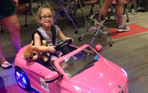 Young girl in a motorized car