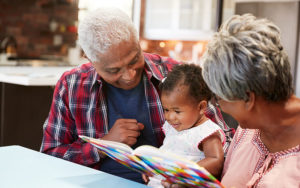 Grandparents reading to their grandchild