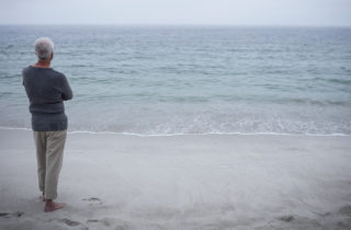 man contemplating at the beach