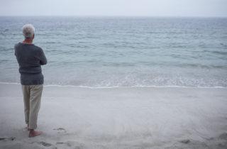 man contemplating at the beach