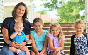 Jessica Alward and her family on a porch swing.