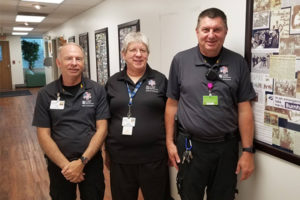 Howard Marsh, Joyce Willskey, and Todd Jones standing in their office at OSF PRO Ambulance.
