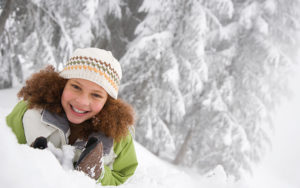 young girl playing in the winter snow