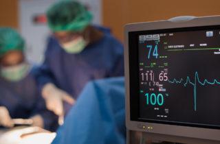 heart transplant team in operating room