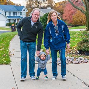 Rick and Angela Farnan along with their son, Blaze taking a stroll in their neighborhood.