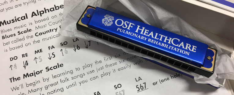 OSF HealthCare harmonica therapy instrument and sheet music