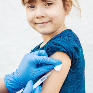 Young girl getting a measles vaccine