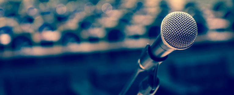 microphone at a podium in an empty hall