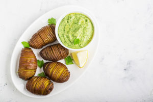 russet potato with guacamole dip