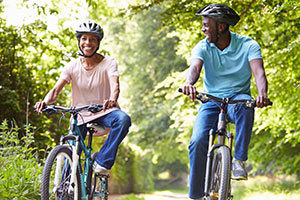 couple riding bicycles in the woods