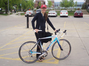 Leann Stickel and bicycle outdoors