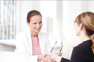 Female varicose vein patient consulting with physician