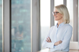 Office leader embracing change and looking out office window