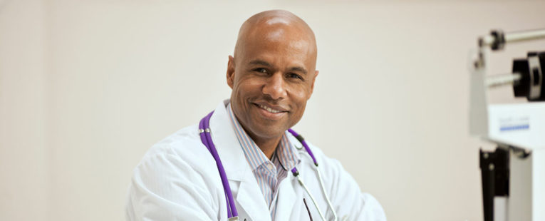 Middle-aged African-American physician in office