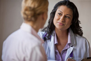 Female patient speaks to female physician