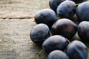 concord grapes on a table