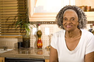 senior African-American woman alone in kitchen