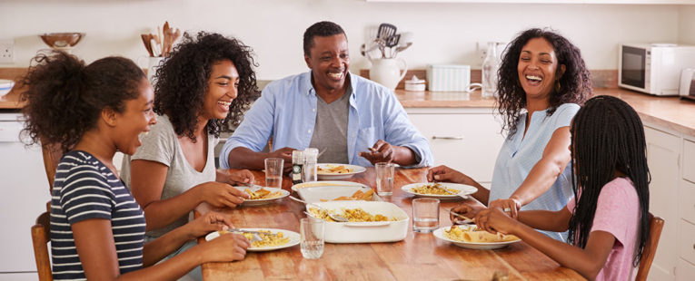 African-American family talking at the breakfast table practicing mindful eating