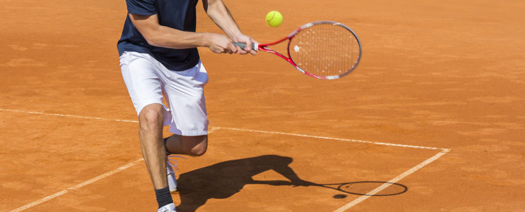 young athlete playing tennis