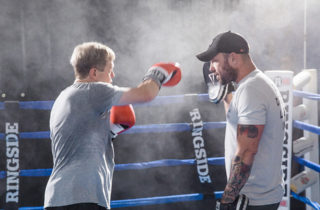 man training in boxing ring