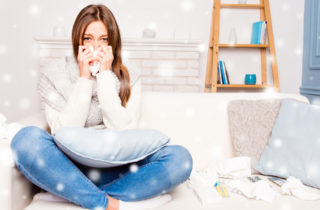 Young woman with allergies in her living room