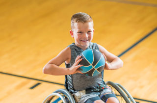 Brantley Williams in wheelchair on the basketball court