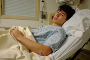 teen male in a hospital bed