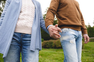 middle-aged couple holding hands