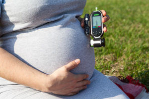 Mom-to-be with gestational diabetes checking blood sugar
