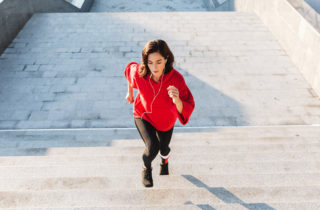 woman excersising by climbing stairs
