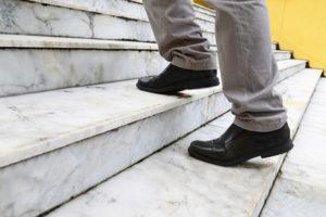 man climbing stairs at work