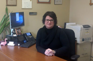 Cherie Reynolds with OSF HealthCare Foundation at work in her office