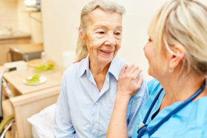 home care therapist and senior woman
