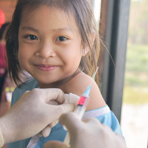 Young girl receiving HPV vaccine at doctor's office
