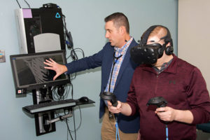 Cardiologist and adult congenital heart patient using virtual reality simulator