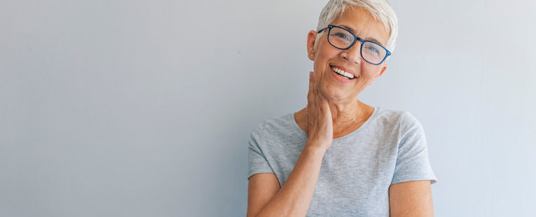 Middle-Aged Woman with glasses after colon cancer screening