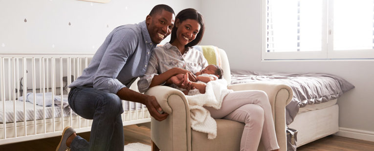 African-American couple with infant son in need of pediatrician
