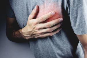 man with vascular disease suffering chest pains