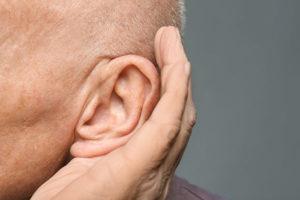 elderly man listening intently