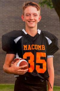 adolescent boy with asthma in football uniform
